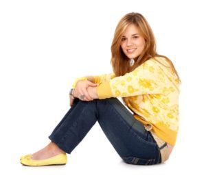 2745086 - blond girl smiling on the floor isolated over a white background