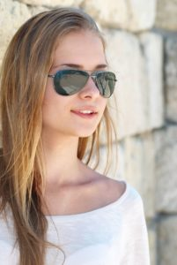 10314292 - beautiful blond girl in the goggles against the ancient wall